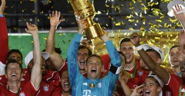 Manuel Neuer und Co. müssen den DFB-Pokal im Jahr 2021 auf alle Fälle abgeben. Foto: John Macdougall/AFP/POOL/dpa