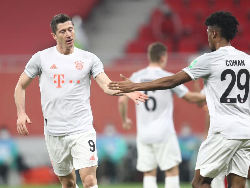 Torjäger Robert Lewandowski (l) war mit zwei Toren Bayerns Sieggarant auf dem Weg ins Finale. Foto: Mahmoud Hefnawy/dpa