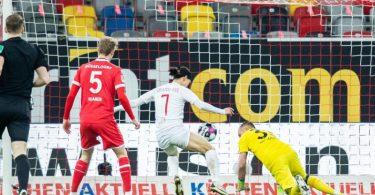 Jae-Sung Lee (M) machte den Kieler Sieg in Düsseldorf perfekt. Foto: Marcel Kusch/dpa