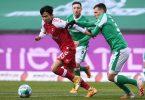 Freiburgs Woo-Yeong Jeong (l) und Bremens Maximilian Eggestein teilten sich mit ihren Teams die Punkte. Foto: Carmen Jaspersen/dpa