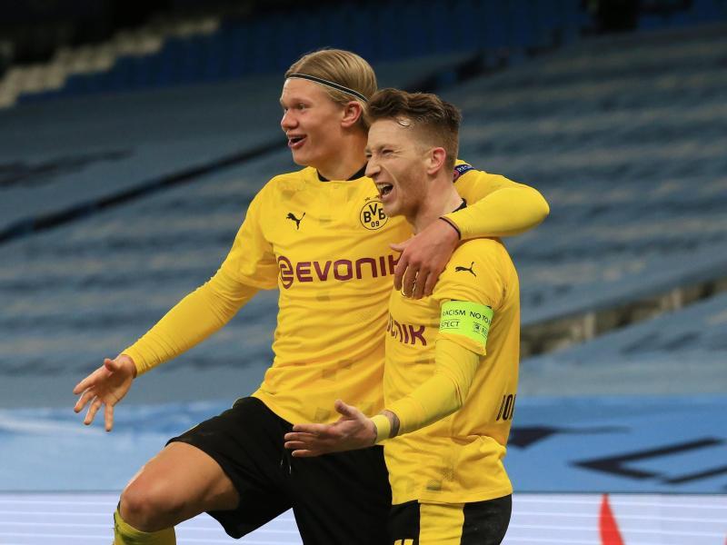 Die Dortmunder um Marco Reus (r) und Erling Haaland sind in der Bundesliga unter Druck. Foto: Lindsey Parnaby/dpa