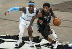 Gerieten beim Lakers-Sieg gegen die Nets nicht nur sportlich aneinander: Dennis Schroeder (l) und Kyrie Irving. Foto: Corey Sipkin/AP/dpa