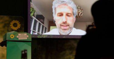 Boris Palmer ist beim Online-Parteitag seines Landesverbands per Video zugeschaltet. Foto: Marijan Murat/dpa