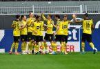 Dortmunds Spieler jubeln nach dem Tor von Stürmer-Juwel Erling Haaland zum frühen 1:0 gegen Bayer 04 Leverkusen. Foto: Martin Meissner/AP-Pool/dpa