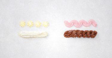 Buttercreme viermal anders: Vanillecreme, Himbeercreme, Nusscreme, Schokoladencreme. Foto: Barbara Bonisolli/Gräfe und Unzer Verlag/dpa-tmn
