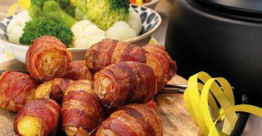 Speck-Kartoffeln eignen sich zum Eintauchen in Käsefondue - zum Beispiel am Silvesterabend. Foto: KMG/Die-Kartoffel.De/dpa-tmn