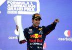 Der Mexikaner Sergio Perez vom Team Red Bull feiert seinen Sieg mit der Trophäe auf dem Podest. Foto: Maxim Shemetov/Pool Reuters/dpa