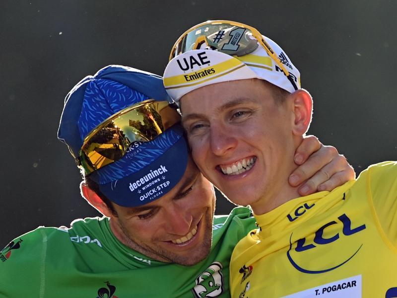 Drückten der 108. Tour de France ihren Stempel auf: Sprintkönig Mark Cavendish (l) und Gesamtsieger Tadej Pogacar. Foto: Pete Goding/BELGA/dpa
