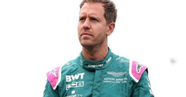 Aston Martin-Pilot Sebastian Vettel steht mit nachdenklicher Miene im Fahrerlager. Foto: Bradley Collyer/PA Wire/dpa