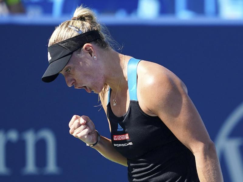 Kerber ballt die Faust und jubelt - gegen Jelena Ostapenko setzt sie sich 4:6, 6:2, 7:5 durch. Foto: Kareem Elgazzar/The Cincinnati Enquirer/AP/dpa