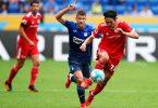 Hoffenheims Stürmer Andrej Kramaric und Unions Mittelfeldspieler Genki Haraguchi (r). Foto: Uwe Anspach/dpa