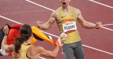 Silbermedaillen-Gewinnerin Irmgard Bensusan feiert Johannes Floors nach dessen Lauf zu Gold. Foto: Marcus Brandt/dpa