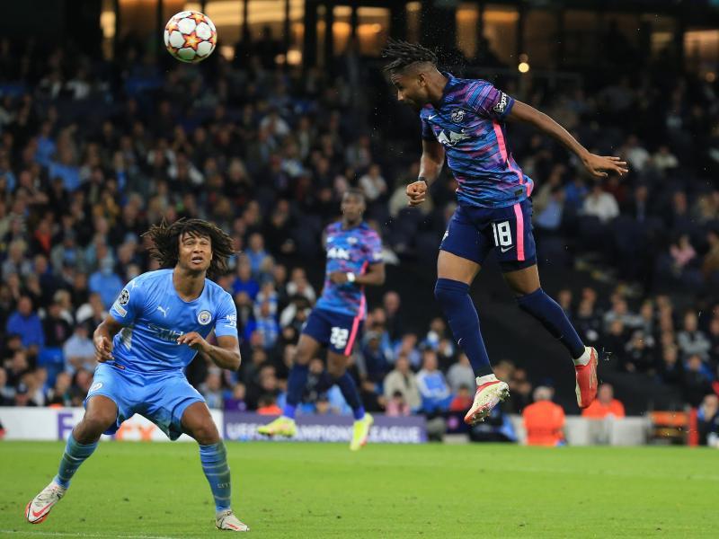 Christopher Nkunku (r) erzielte alle Leipziger Treffer. Foto: Parnaby Lindsey/dpa