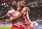 Leipzigs Amadou Haidara (l-r), Tyler Adams und Christopher Nkunku jubeln nach Nkunkus Treffer zum 3:0. Foto: Jan Woitas/dpa-Zentralbild/dpa