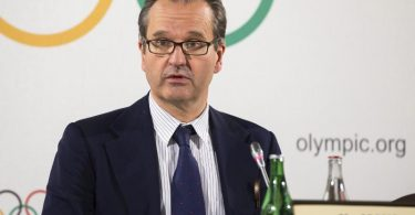 IOC-Sprecher Mark Adams spricht auf einer Pressekonferenz. Foto: Cyril Zingaro/KEYSTONE/dpa/Archivbild